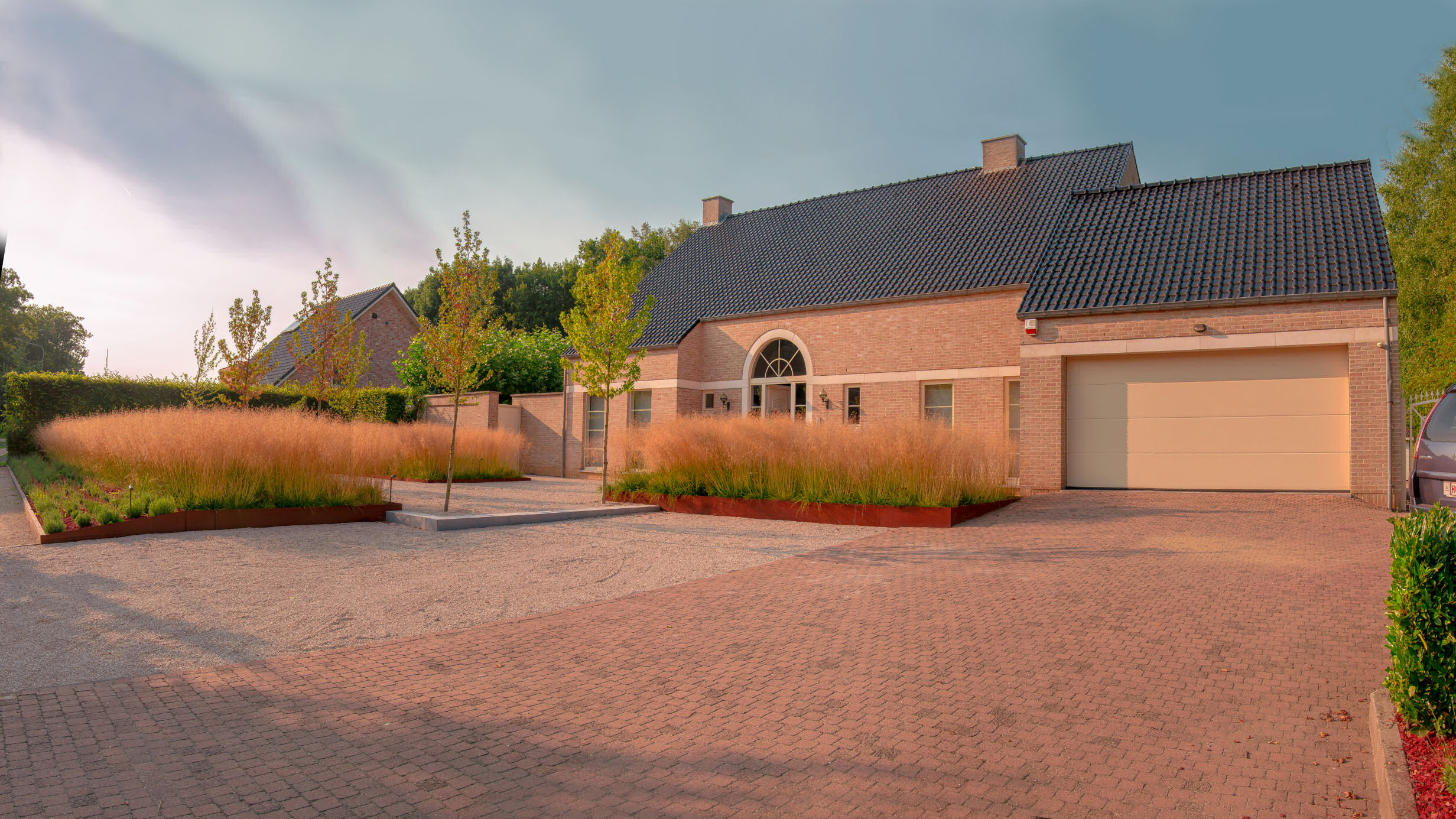 tuinarchitectuur, cortenstaal, tuinontwerp, grassentuin, tijdloos
